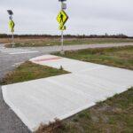 A new sidewalk and ADA accessible crosswalk between Martin Creek Park and Big Bull Creek Park