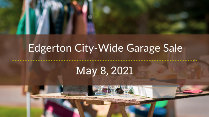 A rack of clothes and a table of knick-knacks are in the background. On top is the words Edgerton City-Wide Garage Sale, May 8, 2021