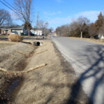 A new improved drainage ditch near the intersection of 1st St and Meriwood